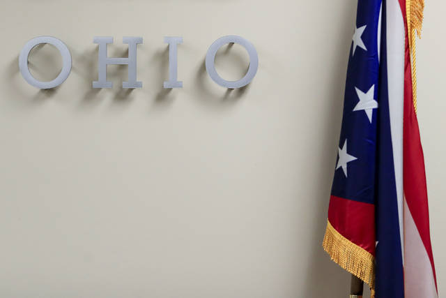 "The U.S. flag sits next to letters spelling ""Ohio"" on a wall at the Hamilton County Board of Elections, Tuesday, Nov. 3, 2020, in Norwood, Ohio. (AP Photo/Aaron Doster)"