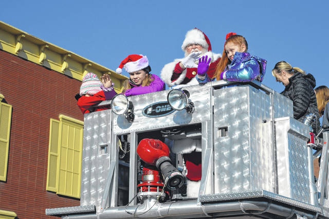 Santa Claus waves from the top of a Gallipolis ladder truck in 2019, as has been tradition for dozens of years in the Gallipolis Christmas Parade. (OVP File Photo)