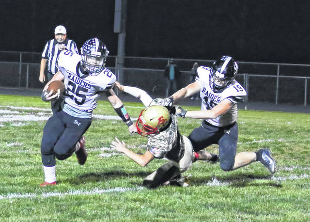 River Valley sophomore Michael Conkle (25) eludes a South Gallia defender during an Oct. 9 football game in Mercerville, Ohio.