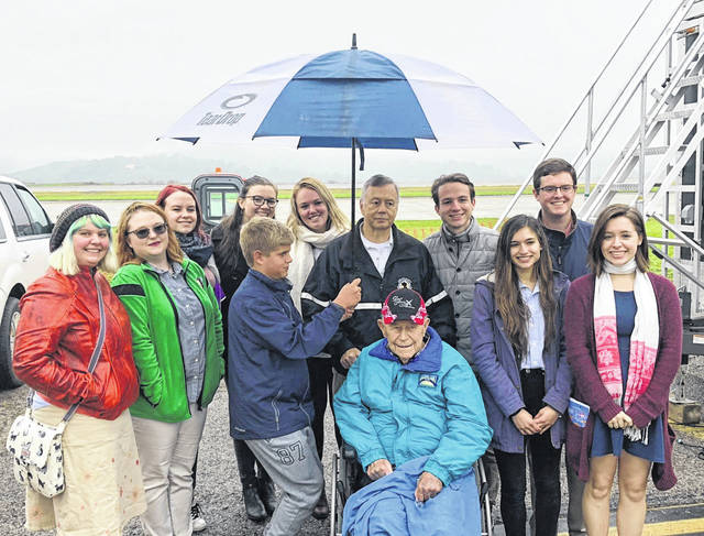 Brig. Gen. Chuck Yeager (seated, center) with Kanawha County Commission President W. Kent Carper (above Yeager) and members of the Society of Yeager Scholars at Marshall University. (MU   Courtesy)
