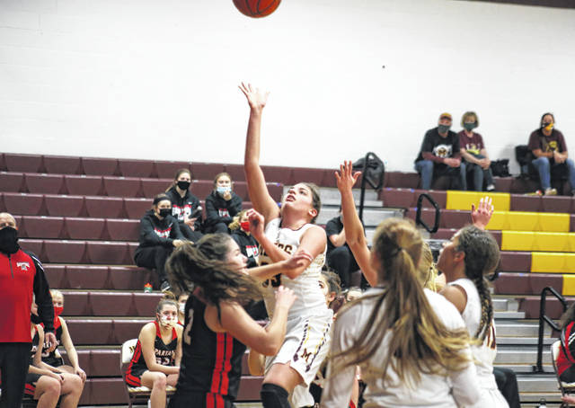 Meigs senior Hannah Durst releases a two-pointer over Alexander's Jadyn Mace (2), during the Lady Spartans' 69-48 victory on Monday in Rocksprings, Ohio.