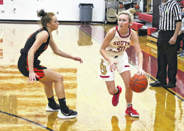 South Gallia senior Kennedey Lambert (20) dribbles past a Belpre defender during the first half of Monday night's TVC Hocking girls basketball game in Mercerville, Ohio.