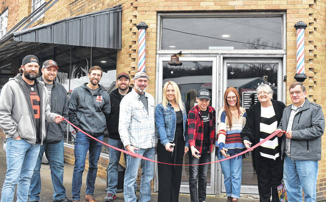Cornerstone Barber Shop & Outfitters recently opened on Second Street in Mason, in the building formerly housing Mason Furniture. Brian O'Neill, who owns the business with wife, Amy, brings 25 years of experience to the shop, and offers a wide variety of cuts, hot towel straight razor shaves, and beard trims. Being avid outdoorsmen who enjoy hunting and kayak fishing, the O'Neill's are also offering fishing poles, tackle and accessories, as well as Jackson Kayaks in their store. They plan to expand in the coming months to offer bait and a wide selection of hunting supplies. A grand opening ribbon cutting was held this week, with the O'Neills, along with Amy's children Makinley and Rogan Bumgarner, pictured as they prepare to cut the ribbon. Also shown, from left, are Pastor Jason Simpkins, Heath Rickard, Jake Marburger, and Derek Putman, all of Northbend Church, and Gloria and John Grate, former building owners. Cornerstone is open Monday through Friday, 8 a.m. to 5:30 p.m., and take walk-ins only. You can reach them at 304-741-6409 or follow them on Instagram at @cornerstonebarbershopoutfitter. (Courtesy photo)