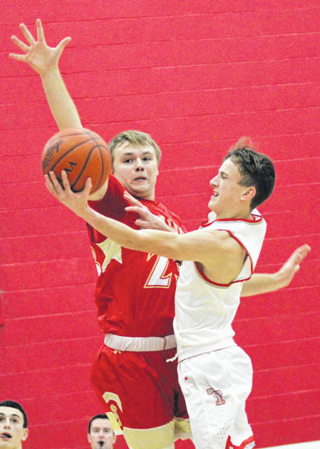 South Gallia junior Tristan Saber defends a shot attempt by a Trimble player during Tuesday night's TVC Hocking boys basketball contest in Glouster, Ohio.