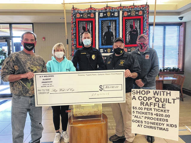 Proceeds from a quilt donated by Albert Proffitt and Pat Barnette were presented to the Shop with a Cop program. Pictured (from left) are Proffitt, Barnette, Pomeroy Police Chief Chris Pitchford, Sheriff Keith Wood and Pomeroy fireman Aaron Oliphant.