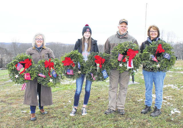 Lila Cooper, second from left, made and sold earrings this year, donating the $600 profit to Wreath Adventures to purchase wreaths for the 2021 event. Cooper is pictured with (from left) Lori Miller, Chuck Mugrage and Peach Mugrage.