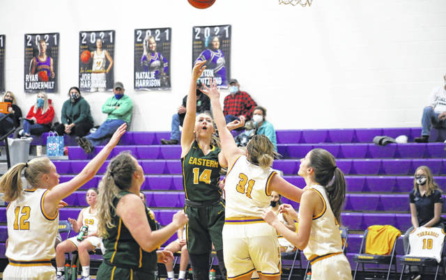 Eastern sophomore Sydney Reynolds (14) shoots a two-pointer over Southern freshman Joy Fitch (31), during the Lady Eagles' 61-12 victory on Monday in Racine, Ohio.