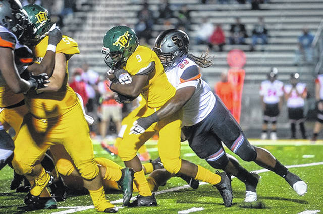 South Charleston defensive end Zeiqui Lawton makes the stop on Huntington's Clarence Rodgers.