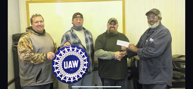 "Oasis Christian Tabernacle recently announced it received a $500 donation from UAW Local 1685 Region 2B towards the church's toy drive for children in the community, calling it ""such a wonderful blessing."" Accepting the donation on behalf of Oasis Christian Tabernacle is Chad Fitch, while presenting the donation is Union President Mike Hurt along with Vice President Mike Broyles and Eric Caldwell. ""We are thankful for those willing to give and help people in our community,"" the church stated. (Courtesy)"