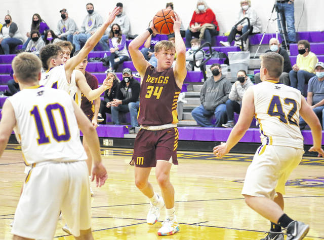 MHS junior Morgan Roberts (34) looks to pass from the high post, during the Marauders' 50-43 victory on Tuesday in Racine, Ohio.