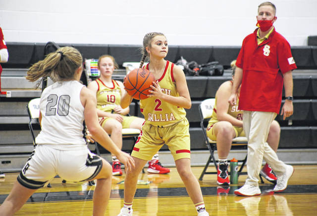South Gallia's Lindsey Wells (2) looks to pass during the Lady Rebels' season-opening setback on Nov. 24 in Bidwell, Ohio.