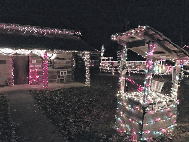 "The annual ""Elf Hunt"" will return this year to the West Virginia State Farm Museum on Tuesday, Dec. 15. Pictured is the farm musem lit up in a previous year during its annual Christmas light show. Also pictured, the ""wishing well"" and Mothman in the distance. (OVP File Photo)"