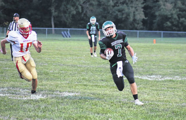 Eastern senior Blake Newland (7) carries the ball across midfield in front of South Gallia junior Alex Oram (10), during a Sept. 11 contest at East Shade River Stadium in Tuppers Plains, Ohio.