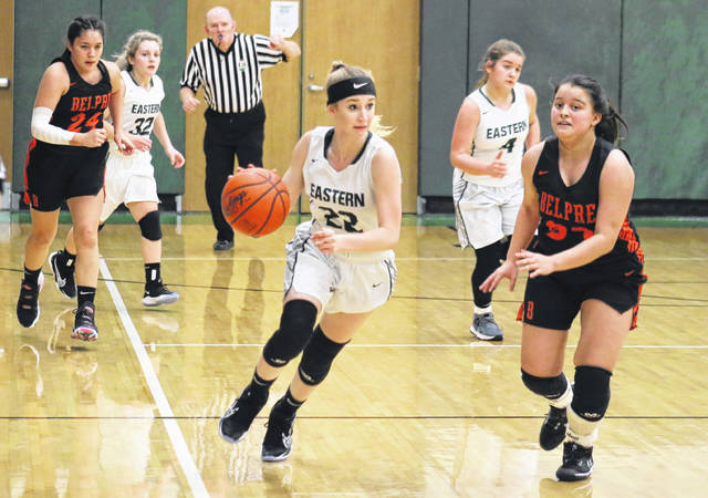 EHS senior Kennadi Rockhold (22) leads a fast break, during Eastern's nine-point loss to Belpre on Monday in Tuppers Plains, Ohio.
