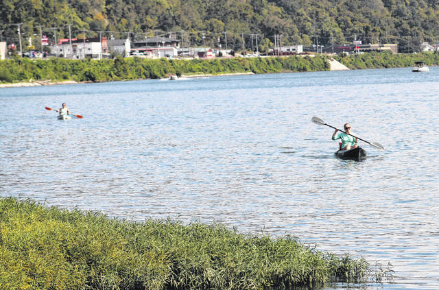 A kayaker approaches the Pomeroy levee during the 2020 Pomeroy Sternwheel Regatta.