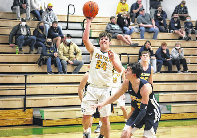 Eastern junior Isaiah Reed (24) shoots a two-pointer over a Wellston defender, during the Golden Rockets' 61-38 victory on Tuesday in Tuppers Plains, Ohio.