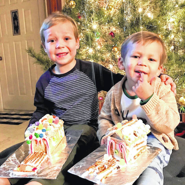 Leo and Max Poole with their gingerbread houses completed in time for Christmas.