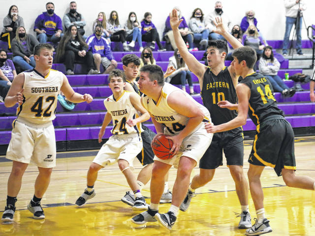 Southern senior Arrow Drummer drives between EHS defenders Matthew Blanchard (10) and Brayden O'Brien (14), and hits a layup in front of teammates Lincoln Rose (42) and Cade Anderson (24), during the Tornadoes' 20-point win on Friday in Racine, Ohio.