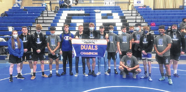 Members of the Gallia Academy wrestling team pose for a picture after winning a dual match against Westfall on Saturday before the start of the 2021 Saunders Duals tournament held in Centenary, Ohio.