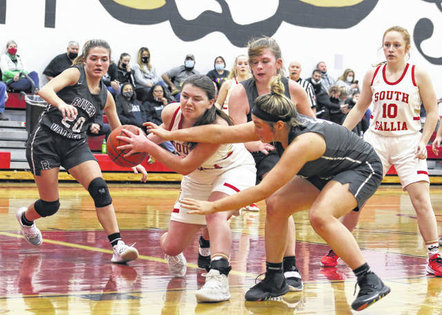 South Gallia junior Jessie Rutt hauls in a rebound and is surrounded by River Valley defenders Lauren Twyman (20), Emma Truance and Allie Holley (5) during the first half of Monday night's girls basketball contest in Mercerville, Ohio.