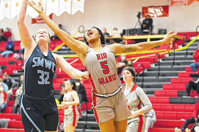 Rio Grande's Hailey Jordan battles Saint Mary-of-the-Woods' Maggie Reimer for a rebound during the first half of Thursday night's game at the Newt Oliver Arena. Jordan had 17 points and five steals in the RedStorm's 82-51 victory over the Pomeroys.