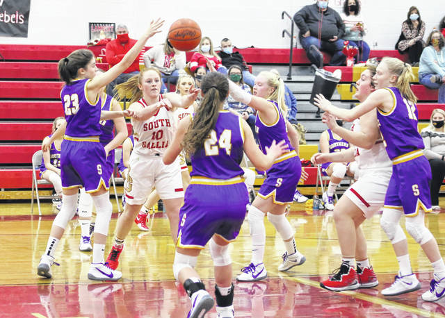South Gallia senior Isabella Cochran (10) fires a pass out of the lane while being surrounded by Southern defenders during the first half of Thursday night's girls basketball contest in Mercerville, Ohio.