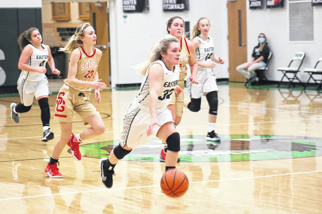Eastern sophomore Juli Durst (21) leads a fast break, during the first half of the Lady Eagles' 52-42 victory on Monday in Tuppers Plains, Ohio.