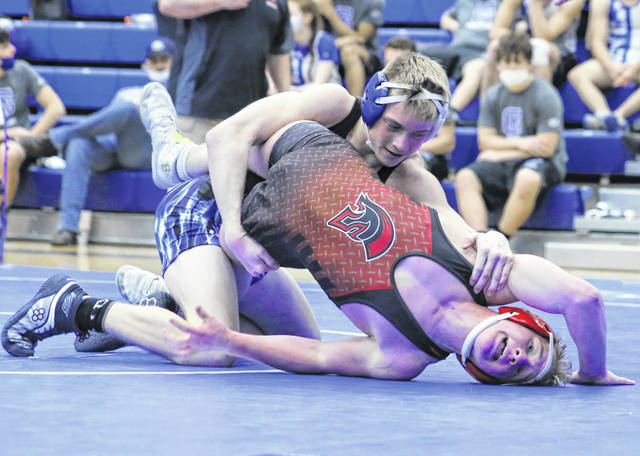 Gallia Academy junior Garytt Schwall locks in a hold an Alexander opponent during a 132-pound wrestling match on Wednesday night at Gallia Academy High School in Centenary, Ohio.