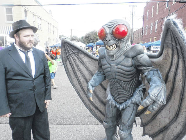 The Mothman Festival, pictured, has grown into one of the largest tourist events for the area, with local downtown shops and the World's Only Mothman Musem, benefiting from the creature's legend year round as tourists explore Point Pleasant, W.Va. (OVP File Photo)