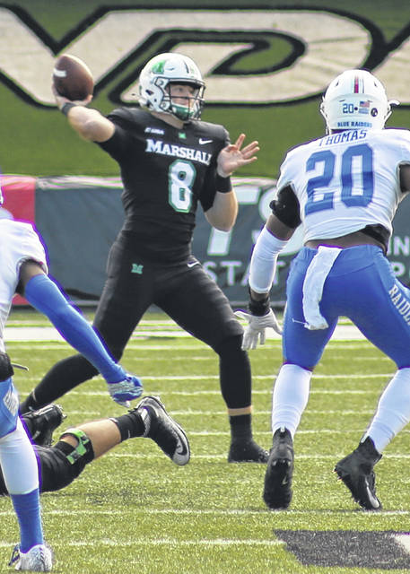 Marshall quarterback Grant Wells (8) delivers a pass during a Nov. 14, 2020, football contest against Middle Tennessee State at Joan C. Edwards Stadium in Huntington, W.Va.