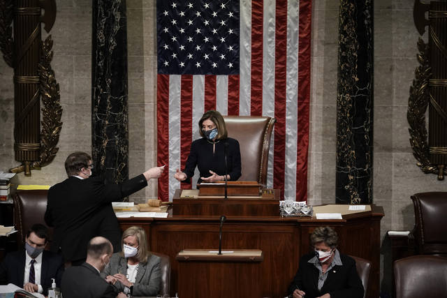 Speaker of the House Nancy Pelosi, D-Calif., leads the final vote of the impeachment of President Donald Trump, for his role in inciting an angry mob to storm the Congress last week, at the Capitol in Washington, Wednesday, Jan. 13, 2021. (AP Photo/J. Scott Applewhite)