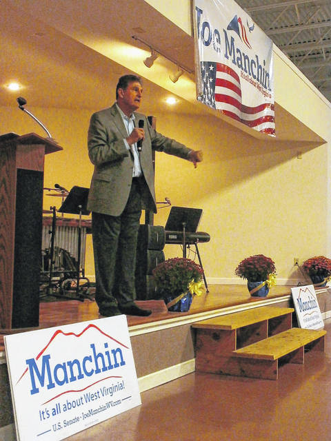 """From a 2018 visit to Mason County, U.S. Senator Joe Manchin pays tribute to the bipartisanship of the late U.S. Senator Jon McCain and McCain's famous """"thumbs down"""" vote to repeal the Affordable Health Care Act. (OVP File Photo)"""