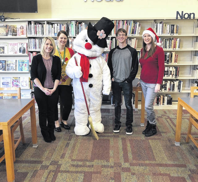 Pictured are Kim Wilcoxon, Laura Erwin, Frosty, Nicholas Sheets and Rachael Barker of the Bossard Library.