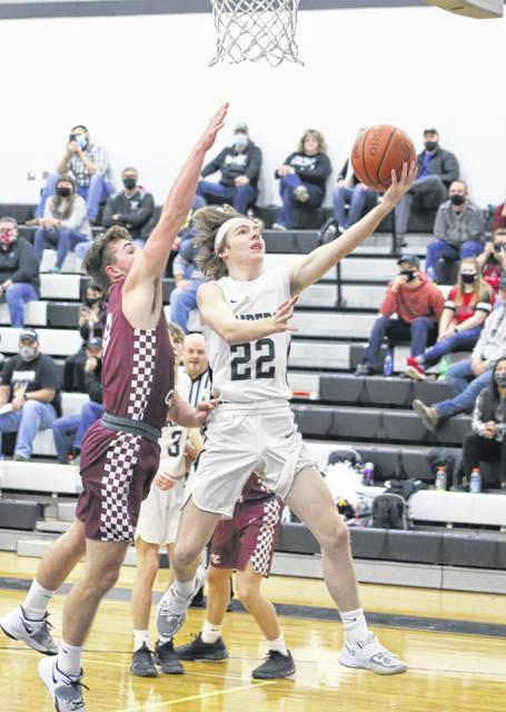River Valley junior Mason Rhodes (22) releases a shot attempt in front of a Vinton County defender during the first half of Friday night's boys basketball contest in Bidwell, Ohio.