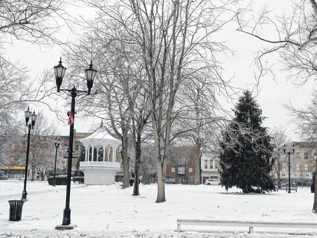 """Ice, snow and freezing temperatures made travel treacherous and caused power outages for some across the area on Tuesday. Meigs, Mason and Gallia counties are also expected to be under a new """"winter storm watch"""" from 7 p.m. on Wednesday (today) to 7 a.m. on Friday. Pictured is a snow-covered Gallipolis City Park Tuesday afternoon. (Suzi Konz 