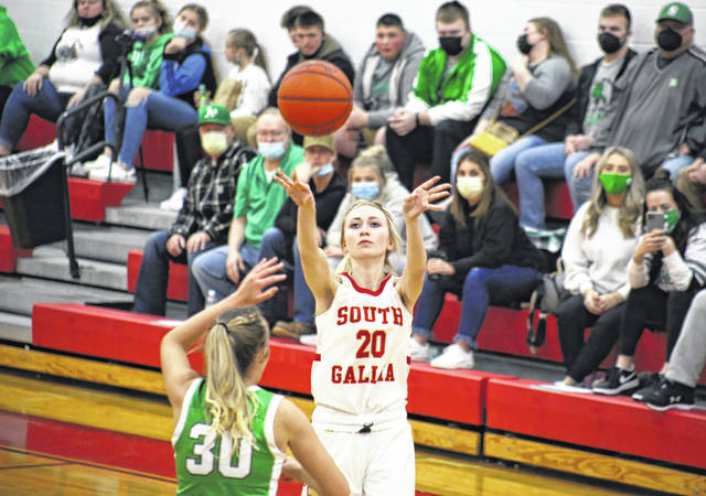 South Gallia senior Kennedey Lambert (20) shoots a jump shot over Green's Kim Brown (30), during the first half of the Lady Bobcats' 59-45 victory on Saturday in Mercerville, Ohio.