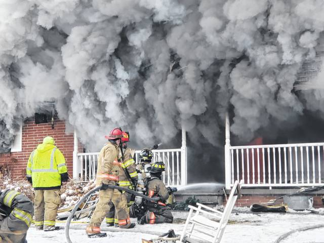 Fire fighters from six departments battled a structure fire on Zion Road throughout the day on Friday.
