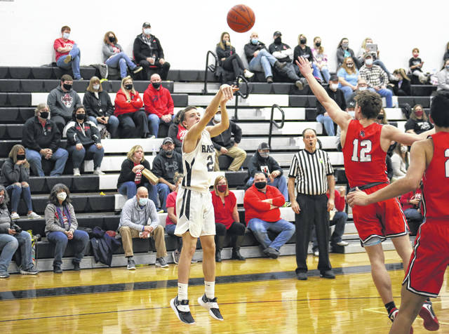 RVHS sophomore Kade Alderman shoots a two-pointer over Alexander's Kyler D'Augustino (12), during the Spartans' 55-41 victory on Monday in Bidwell, Ohio.