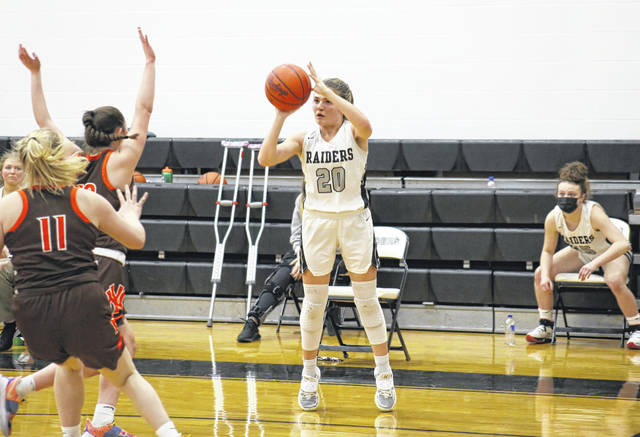 RVHS junior Lauren Twyman (20) fires a three-pointer, during the Lady Raiders' 52-47 loss to Nelsonville-York on Tuesday in Bidwell, Ohio.