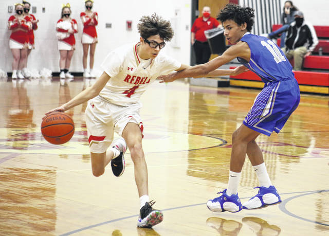 South Gallia junior Blaik Saunders (4) drives past an East's Devin Alland, during the first half of the Rebels' 73-31 victory on Wednesday in Mercerville, Ohio.
