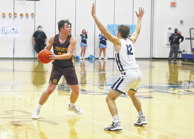 Meigs senior Wyatt Hoover (32) looks to make a pass during the second half of Friday night's Division III Southeast 1 sectional final against Adena in Frankfort, Ohio.