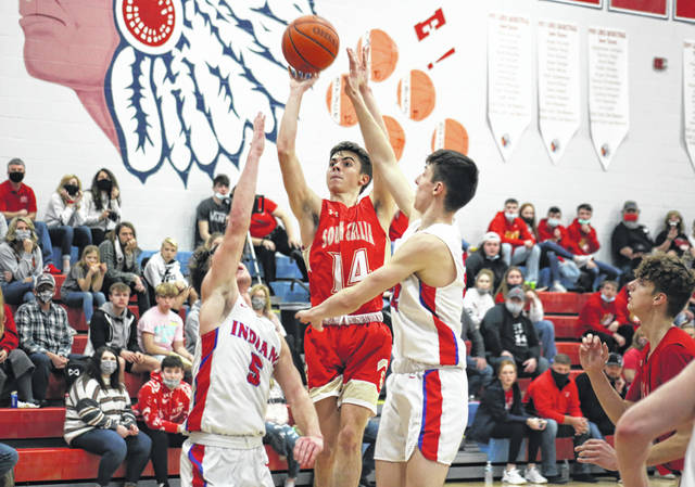 South Gallia senior Andrew Small (14) shoots a two-pointer over a pair of PHS defenders, during the Rebels' 67-50 loss on Saturday in Peebles, Ohio.