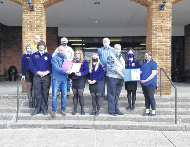 Pictured are Gallia County Commissioners Harold G. Montgomery, M. Eugene Greene and Q. Jay Stapleton presenting a proclamation declaring FFA Week in Gallia County. Also pictured from local FFA Chapters are Gallia Academy FFA Advisor Katherine Dickson and Erin Pope; River Valley FFA Advisor Mathew Houck, Taylor Huck and Ryan Weber; South Gallia FFA Advisor David Pope, Emma Shamblin and Ryleigh Halley. (Gallia County Commission | Courtesy)