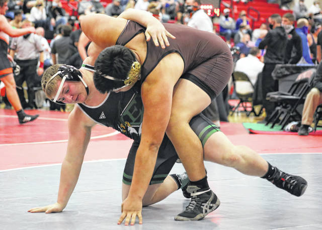 Eastern senior Steven Fitzgerald, left, maintains his balance while trying to execute a hip toss against Pymatuning Valley senior Victor Verba during the opening round of the Division III heavyweight championships held Saturday at Marion Franklin High School in Marion, Ohio.