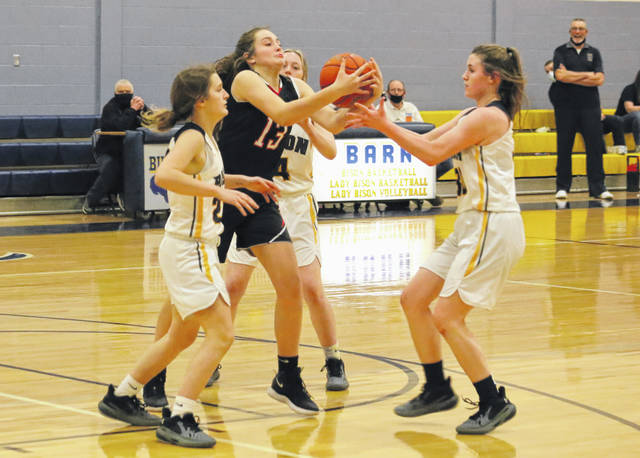 Point Pleasant freshman McKenna Young battles for a loose ball between a trio of Buffalo players during the second half of Wednesday night's girls basketball contest in Buffalo, W.Va.