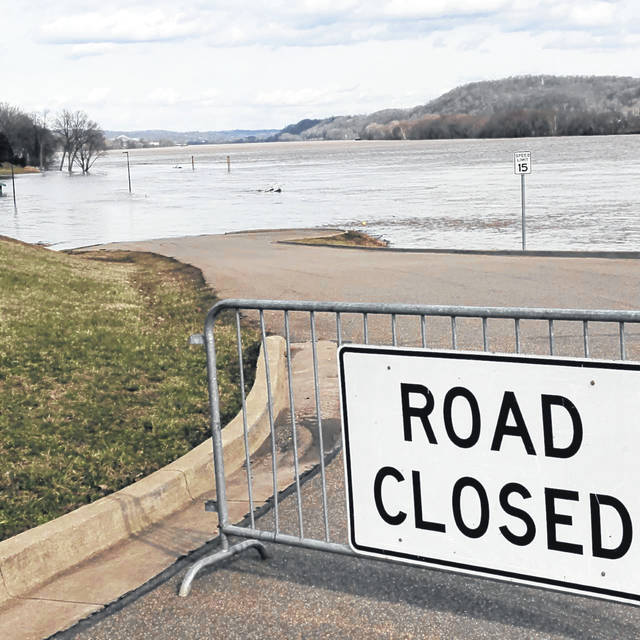 The Ohio River floods into the parking lot of the Public Use Area in downtown Gallipolis on Monday afternoon. (Matt Rodgers | OVP)