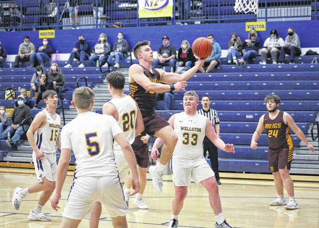 Meigs junior Coulter Cleland releases a shot attempt during a Division III sectional tournament game against Wellston on Feb. 22 in Wellston, Ohio.