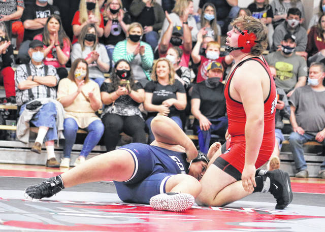 Point Pleasant senior Nick Ball rises to his knees after scoring a pinfall victory over Parkersburg South in the heavyweight division on Tuesday night during a wrestling quad held in Point Pleasant, W.Va.