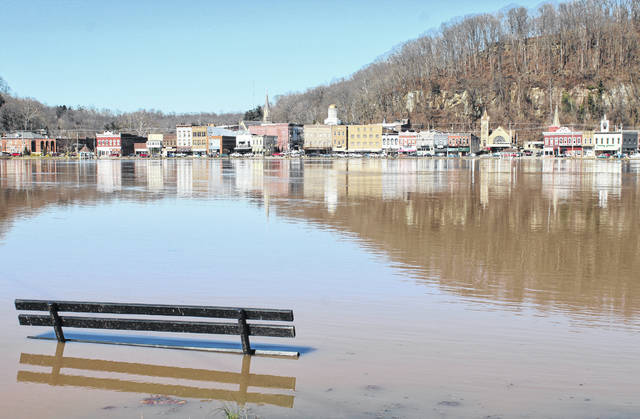 A view from the Mason, W.Va. boat ramp shows the Ohio River nearing flood stage in Pomeroy on Tuesday afternoon.