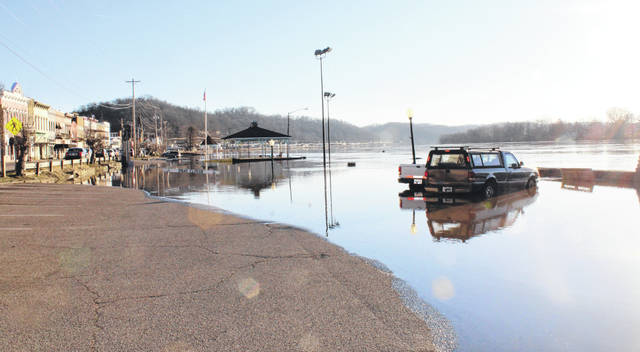 Two vehicles were parked in flood waters on Tuesday morning on the Pomeroy Parking Lot.